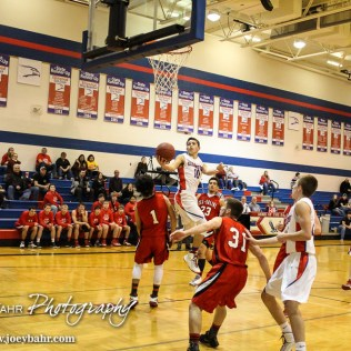 Ellinwood Eagle Tyson Martinez (#10) goes up for a layup during the 2A Sub-State First Round Game with the Ellinwood Eagles vs the Ell-Saline Cardinals with Ellinwood winning 59 to 37 at Ellinwood High School in Ellinwood, Kansas on March 2, 2015. (Photo: Joey Bahr, www.joeybahr.com)