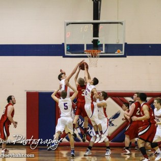 The Ellinwood Eagles swam to block a shot from Ell-Saline Cardinal Tyler Weems (#3) during the 2A Sub-State First Round Game with the Ellinwood Eagles vs the Ell-Saline Cardinals with Ellinwood winning 59 to 37 at Ellinwood High School in Ellinwood, Kansas on March 2, 2015. (Photo: Joey Bahr, www.joeybahr.com)