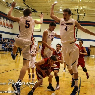 Ell-Saline Cardinal Cody Walters (#31) puts the brakes on as three Ellinwood Eagles fly by during the 2A Sub-State First Round Game with the Ellinwood Eagles vs the Ell-Saline Cardinals with Ellinwood winning 59 to 37 at Ellinwood High School in Ellinwood, Kansas on March 2, 2015. (Photo: Joey Bahr, www.joeybahr.com)