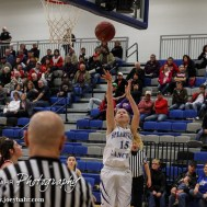 Spearville Lady Lancer Erica Hornung-Heeke (#15) goes up for a layup during the 2A Sub-State First Round Game with the Spearville Lady Lancers vs the Kinsley Lady Coyotes with Spearville winning 66 to 53 at Spearville High School in Spearville, Kansas on March 3, 2015. (Photo: Joey Bahr, www.joeybahr.com)