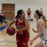 Kinsley Lady Coyote Gisel Holguin (#11) looks for a teammate to pass to during the 2A Sub-State First Round Game with the Spearville Lady Lancers vs the Kinsley Lady Coyotes with Spearville winning 66 to 53 at Spearville High School in Spearville, Kansas on March 3, 2015. (Photo: Joey Bahr, www.joeybahr.com)