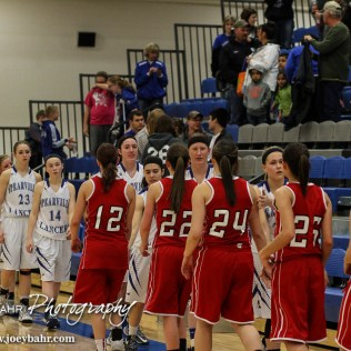 Members of the Kinsley Lady Coyotes and Spearville Lady Lancers shake hands following the 2A Sub-State First Round Game with the Spearville Lady Lancers vs the Kinsley Lady Coyotes with Spearville winning 66 to 53 at Spearville High School in Spearville, Kansas on March 3, 2015. (Photo: Joey Bahr, www.joeybahr.com)
