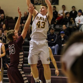 Hays Indian Shane Berens (#43) goes up for a layup during the 4A Division I Sub-State First Round Game with the Hays Indians and Buhler Crusaders with Hays winning 60 to 53 at Hays High School in Hays, Kansas on March 5, 2015. (Photo: Joey Bahr, www.joeybahr.com)