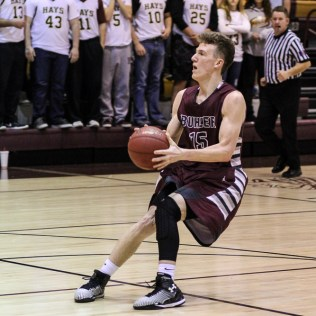 Buhler Crusader Noah Webster (#15) stops to take a shot during the 4A Division I Sub-State First Round Game with the Hays Indians and Buhler Crusaders with Hays winning 60 to 53 at Hays High School in Hays, Kansas on March 5, 2015. (Photo: Joey Bahr, www.joeybahr.com)