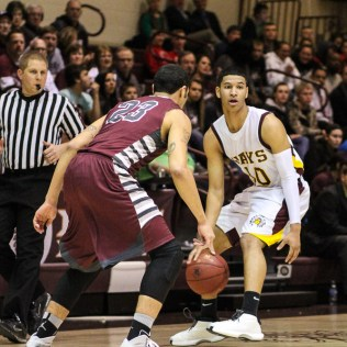 Hays Indian Isaiah Nunnery (#10) looks for a teammate to pass to during the 4A Division I Sub-State First Round Game with the Hays Indians and Buhler Crusaders with Hays winning 60 to 53 at Hays High School in Hays, Kansas on March 5, 2015. (Photo: Joey Bahr, www.joeybahr.com)