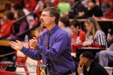 Minneapolis Lion Head Coach John Darrow talks to his players during the 2016 Hoisington Winter Jam Boys Championship Basketball game between the Hoisington Cardinals and the Minneapolis Lions with Hoisington winning 39 to 38 of Hoisington Activity Center in Hoisington, Kansas on January 23, 2016. (Photo: Joey Bahr, www.joeybahr.com)