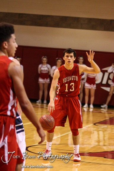 Hoisington Cardinal Corbin Crawford (#13) calls a play during the 2016 Hoisington Winter Jam Boys Championship Basketball game between the Hoisington Cardinals and the Minneapolis Lions with Hoisington winning 39 to 38 of Hoisington Activity Center in Hoisington, Kansas on January 23, 2016. (Photo: Joey Bahr, www.joeybahr.com)