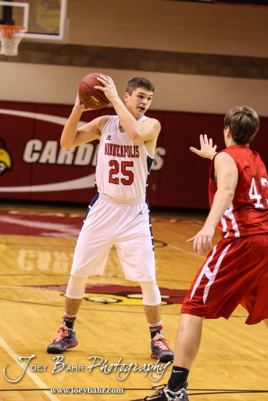 Minneapolis Lion Jace McKinney (#25) looks for a teammate to pass the ball to during the 2016 Hoisington Winter Jam Boys Championship Basketball game between the Hoisington Cardinals and the Minneapolis Lions with Hoisington winning 39 to 38 of Hoisington Activity Center in Hoisington, Kansas on January 23, 2016. (Photo: Joey Bahr, www.joeybahr.com)