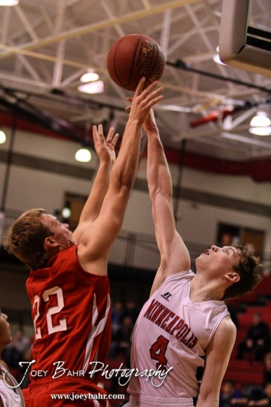 Minneapolis Lion Gavin Rothenberger (#4) blocks a shot by Hoisington Cardinal Grant Dolechek (#22) during the 2016 Hoisington Winter Jam Boys Championship Basketball game between the Hoisington Cardinals and the Minneapolis Lions with Hoisington winning 39 to 38 of Hoisington Activity Center in Hoisington, Kansas on January 23, 2016. (Photo: Joey Bahr, www.joeybahr.com)