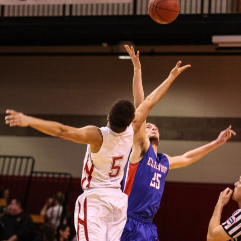 Hoisington Cardinal Cameron Davis (#5) and Ellinwood Eagle Cody Wondra (#25) jump for the opening tipoff during the 2016 Hoisington Winter Jam Boys Semi-Final Basketball game between the Hoisington Cardinals and the Ellinwood Eagles with Hoisington winning 42 to 39 of Hoisington Activity Center in Hoisington, Kansas on January 22, 2016. (Photo: Joey Bahr, www.joeybahr.com)