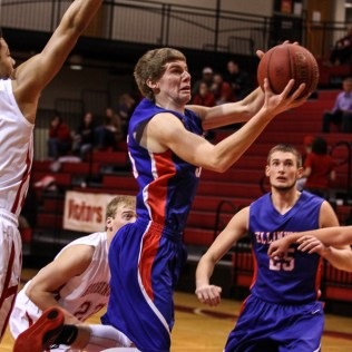 Ellinwood Eagle Nathan Monday (#35) jumps up for a layup during the 2016 Hoisington Winter Jam Boys Semi-Final Basketball game between the Hoisington Cardinals and the Ellinwood Eagles with Hoisington winning 42 to 39 of Hoisington Activity Center in Hoisington, Kansas on January 22, 2016. (Photo: Joey Bahr, www.joeybahr.com)