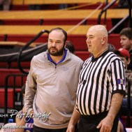 Ellinwood Eagle Head Coach Derek Joiner and Referee Mark Brock discuss a call during the 2016 Hoisington Winter Jam Boys Semi-Final Basketball game between the Hoisington Cardinals and the Ellinwood Eagles with Hoisington winning 42 to 39 of Hoisington Activity Center in Hoisington, Kansas on January 22, 2016. (Photo: Joey Bahr, www.joeybahr.com)