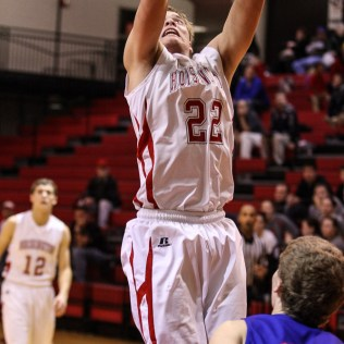 Hoisington Cardinal Grant Dolechek (#22) goes for a layup during the 2016 Hoisington Winter Jam Boys Semi-Final Basketball game between the Hoisington Cardinals and the Ellinwood Eagles with Hoisington winning 42 to 39 of Hoisington Activity Center in Hoisington, Kansas on January 22, 2016. (Photo: Joey Bahr, www.joeybahr.com)