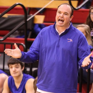 Ellinwood Eagle Head Coach Derek Joiner talks to his players during the 2016 Hoisington Winter Jam Boys Thrid Place Basketball game between the Ellinwood Eagles and the Russell Broncos with Ellinwood winning 47 to 37 of Hoisington Activity Center in Hoisington, Kansas on January 23, 2016. (Photo: Joey Bahr, www.joeybahr.com)