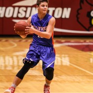 Ellinwood Eagle Tyson Martinez (#10) looks for a teammate to pass the ball to during the 2016 Hoisington Winter Jam Boys Thrid Place Basketball game between the Ellinwood Eagles and the Russell Broncos with Ellinwood winning 47 to 37 of Hoisington Activity Center in Hoisington, Kansas on January 23, 2016. (Photo: Joey Bahr, www.joeybahr.com)