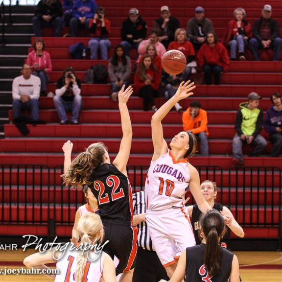 Otis-Bison Lady Cougar Taylor Regan (#10) and Ellsworth Lady Bearcat Kolby Davis (#22) jump for the opening tip off during the 2016 Hoisington Winter Jam Girls Fifth Place Basketball game between the Otis-Bison Lady Cougars and the Ellsworth Lady Bearcats with Otis-Bison winning 46 to 40 of Hoisington Activity Center in Hoisington, Kansas on January 23, 2016. (Photo: Joey Bahr, www.joeybahr.com)