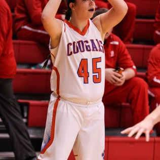 Otis-Bison Lady Cougar Megan Tammen (#45) looks for a teammate to pass the ball to during the 2016 Hoisington Winter Jam Girls Fifth Place Basketball game between the Otis-Bison Lady Cougars and the Ellsworth Lady Bearcats with Otis-Bison winning 46 to 40 of Hoisington Activity Center in Hoisington, Kansas on January 23, 2016. (Photo: Joey Bahr, www.joeybahr.com)