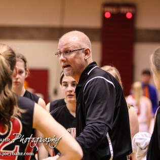 Ellsworth Lady Bearcat Head Coach Ken Cravens talks to his players during a timeout in the 2016 Hoisington Winter Jam Girls Fifth Place Basketball game between the Otis-Bison Lady Cougars and the Ellsworth Lady Bearcats with Otis-Bison winning 46 to 40 of Hoisington Activity Center in Hoisington, Kansas on January 23, 2016. (Photo: Joey Bahr, www.joeybahr.com)
