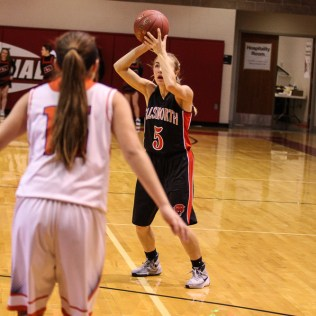 Ellsworth Lady Bearcat Paige Talbott (#5) looks for a teammate to pass the ball to during the 2016 Hoisington Winter Jam Girls Fifth Place Basketball game between the Otis-Bison Lady Cougars and the Ellsworth Lady Bearcats with Otis-Bison winning 46 to 40 of Hoisington Activity Center in Hoisington, Kansas on January 23, 2016. (Photo: Joey Bahr, www.joeybahr.com)