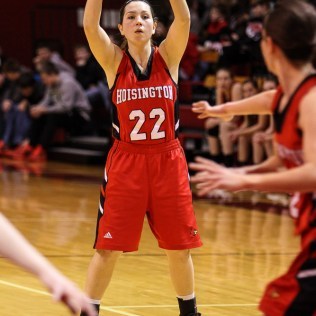 Hoisington Lady Cardinal Marisa Jonas (#22) looks for a teammate to pass the ball to during the 2016 Hoisington Winter Jam Girls Semi-Final Basketball game between the LaCrosse Lady Leopards and the Hoisington Lady Cardinals with LaCrosse winning 42 to 39 of Hoisington Activity Center in Hoisington, Kansas on January 22, 2016. (Photo: Joey Bahr, www.joeybahr.com)