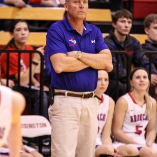 Russell Lady Bronco Head Coach Frank Schulte watches a play develop during the 2016 Hoisington Winter Jam Girls Championship Basketball game between the LaCrosse Lady Leopards and the Russell Lady Broncos with LaCrosse winning 54 to 48 of Hoisington Activity Center in Hoisington, Kansas on January 23, 2016. (Photo: Joey Bahr, www.joeybahr.com)