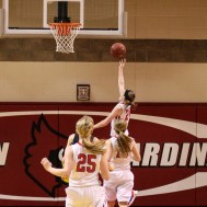 Russell Lady Bronco Megan Boxberger (#24) goes for a layup during the 2016 Hoisington Winter Jam Girls Championship Basketball game between the LaCrosse Lady Leopards and the Russell Lady Broncos with LaCrosse winning 54 to 48 of Hoisington Activity Center in Hoisington, Kansas on January 23, 2016. (Photo: Joey Bahr, www.joeybahr.com)