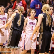 Members of the LaCrosse Lady Leopards and Russell Lady Broncos shake hands following the 2016 Hoisington Winter Jam Girls Championship Basketball game between the LaCrosse Lady Leopards and the Russell Lady Broncos with LaCrosse winning 54 to 48 of Hoisington Activity Center in Hoisington, Kansas on January 23, 2016. (Photo: Joey Bahr, www.joeybahr.com)