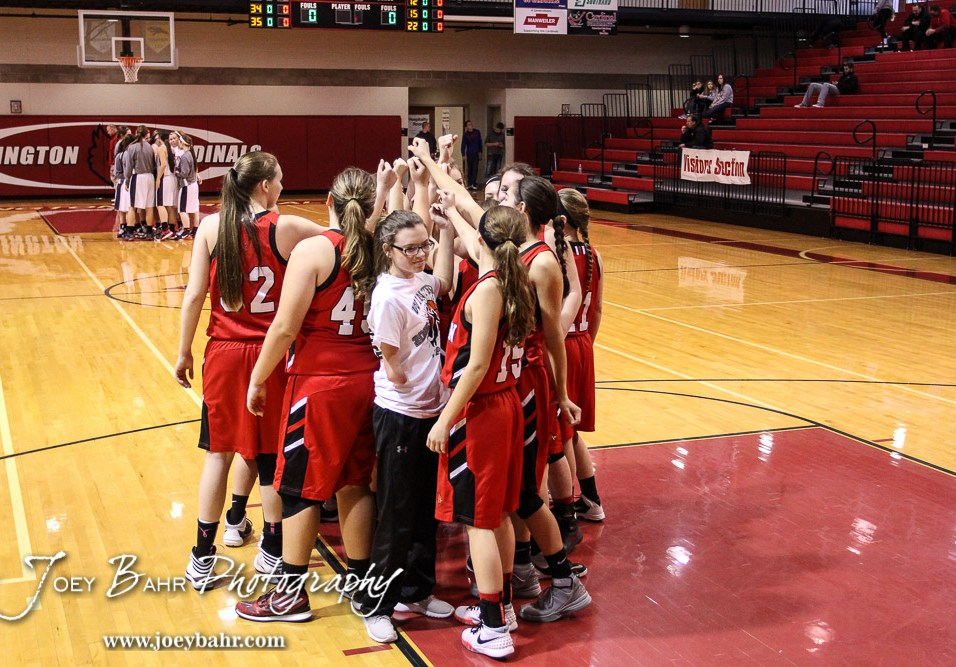 The Hoisington Lady Cardinals huddle prior to the 2016 Hoisington Winter Jam Girls Thrid Place Basketball game between the Hoisington Lady Cardinals and the Minneapolis Lady Lions with Hoisington winning 48 to 43 of Hoisington Activity Center in Hoisington, Kansas on January 23, 2016. (Photo: Joey Bahr, www.joeybahr.com)