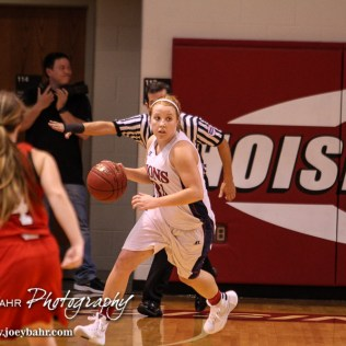 Minneapolis Lady Lion Nicole Forte (#34) looks for a teammate to pass the ball to during the 2016 Hoisington Winter Jam Girls Thrid Place Basketball game between the Hoisington Lady Cardinals and the Minneapolis Lady Lions with Hoisington winning 48 to 43 of Hoisington Activity Center in Hoisington, Kansas on January 23, 2016. (Photo: Joey Bahr, www.joeybahr.com)