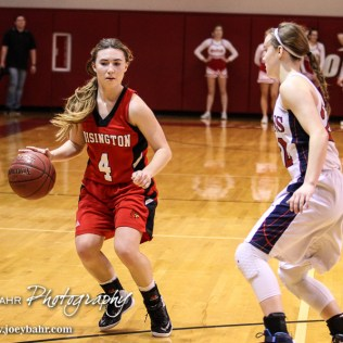 Hoisington Lady Cardinal Karisa Schremmer (#4) looks for an open lane during the 2016 Hoisington Winter Jam Girls Thrid Place Basketball game between the Hoisington Lady Cardinals and the Minneapolis Lady Lions with Hoisington winning 48 to 43 of Hoisington Activity Center in Hoisington, Kansas on January 23, 2016. (Photo: Joey Bahr, www.joeybahr.com)