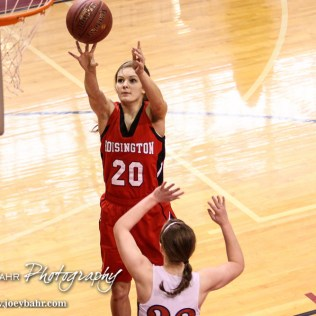 Hoisington Lady Cardinal Vikki Donetz (#20) takes a shot over Minneapolis Lady Lion Lindsay Shupe (#22) during the 2016 Hoisington Winter Jam Girls Thrid Place Basketball game between the Hoisington Lady Cardinals and the Minneapolis Lady Lions with Hoisington winning 48 to 43 of Hoisington Activity Center in Hoisington, Kansas on January 23, 2016. (Photo: Joey Bahr, www.joeybahr.com)