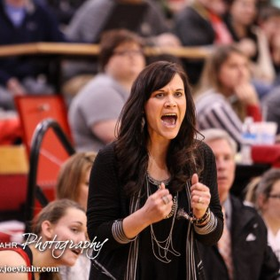 Hoisington Lady Cardinal Head Coach Mandy Mason celebrates a made shot during the 2016 Hoisington Winter Jam Girls Thrid Place Basketball game between the Hoisington Lady Cardinals and the Minneapolis Lady Lions with Hoisington winning 48 to 43 of Hoisington Activity Center in Hoisington, Kansas on January 23, 2016. (Photo: Joey Bahr, www.joeybahr.com)