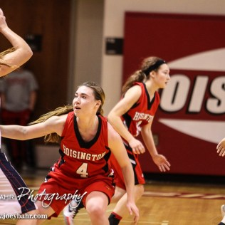 Hoisington Lady Cardinal Karisa Schremmer (#4) defends Minneapolis Lady Lion Nicole Forte (#34) during the 2016 Hoisington Winter Jam Girls Thrid Place Basketball game between the Hoisington Lady Cardinals and the Minneapolis Lady Lions with Hoisington winning 48 to 43 of Hoisington Activity Center in Hoisington, Kansas on January 23, 2016. (Photo: Joey Bahr, www.joeybahr.com)