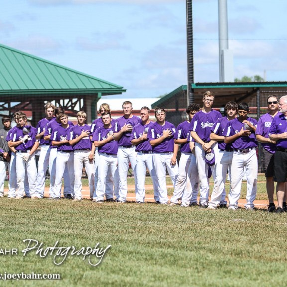 The Medicine Lodge Indians line up for the playing of the National Anthem. The St. Mary's Colgan Panthers win the KSHSAA Class 2-1A State Baseball Championship over the Medicine Lodge Indians by a score of 13 to 3 at the Great Bend Sports Complex in Great Bend, Kansas on May 28, 2016. (Photo: Joey Bahr, www.joeybahr.com)