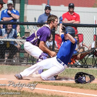 St. Mary's Colgan Panther Garrett VanBecelaere (#9) slides into home as Medicine Lodge Indian William Axeline (#1) waits for the ball. The St. Mary's Colgan Panthers win the KSHSAA Class 2-1A State Baseball Championship over the Medicine Lodge Indians by a score of 13 to 3 at the Great Bend Sports Complex in Great Bend, Kansas on May 28, 2016. (Photo: Joey Bahr, www.joeybahr.com)