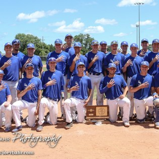 The St. Mary's Colgan Panthers hold up four fingers in a team photo to signify their fourth straight Baseball Championship. The St. Mary's Colgan Panthers win the KSHSAA Class 2-1A State Baseball Championship over the Medicine Lodge Indians by a score of 13 to 3 at the Great Bend Sports Complex in Great Bend, Kansas on May 28, 2016. (Photo: Joey Bahr, www.joeybahr.com)