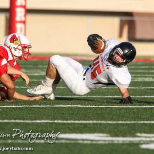 Larned Indian Landon Erway (#45) tries to stay in play during the Hoisington Cardinal versus Larned Indian Football game with Hoisington winning 53 to 21 at Elton Brown Field in Hoisington, Kansas on September 4, 2015. (Photo: Joey Bahr, www.joeybahr.com)