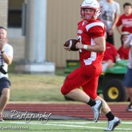 Hoisington Cardinal Hunter Hanzlick (#27) runs to the end zone during the Hoisington Cardinal versus Larned Indian Football game with Hoisington winning 53 to 21 at Elton Brown Field in Hoisington, Kansas on September 4, 2015. (Photo: Joey Bahr, www.joeybahr.com)