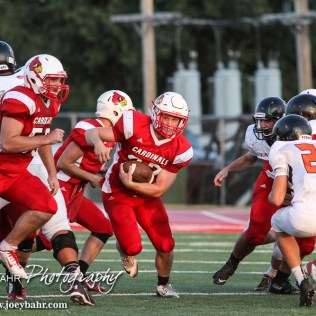 Hoisington Cardinal Hunter Hanzlick (#27) finds a big hole during the Hoisington Cardinal versus Larned Indian Football game with Hoisington winning 53 to 21 at Elton Brown Field in Hoisington, Kansas on September 4, 2015. (Photo: Joey Bahr, www.joeybahr.com)