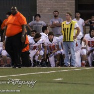 The Larned Indians take a knee as trainers tend to an injured teammate during the Hoisington Cardinal versus Larned Indian Football game with Hoisington winning 53 to 21 at Elton Brown Field in Hoisington, Kansas on September 4, 2015. (Photo: Joey Bahr, www.joeybahr.com)