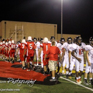 Members of the Larned Indians and Hoisington Cardinals shake hands following the Hoisington Cardinal versus Larned Indian Football game with Hoisington winning 53 to 21 at Elton Brown Field in Hoisington, Kansas on September 4, 2015. (Photo: Joey Bahr, www.joeybahr.com)