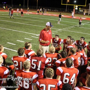 Hoisington Cardinal Head Coach Zach Baird talks to his players following the Hoisington Cardinal versus Larned Indian Football game with Hoisington winning 53 to 21 at Elton Brown Field in Hoisington, Kansas on September 4, 2015. (Photo: Joey Bahr, www.joeybahr.com)