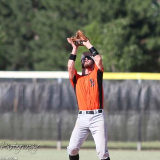 Larned Indian Landon Erway (#10) holds up his glove to catch a fly ball. The Great Bend Chiefs win game 1 of a American Legion baseball double header over the Larned Indians 7 to 6 after 8 innings at the Great Bend Sports Complex in Great Bend, Kansas on June 29, 2016. (Photo: Joey Bahr, www.joeybahr.com)