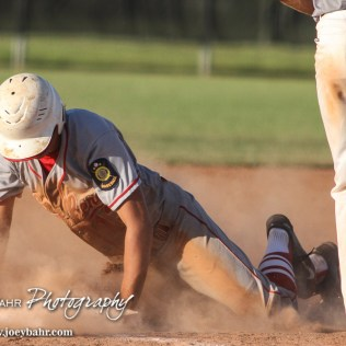 Great Bend Chief Kody Lang (#13) slides into Third Base on a double steal. The Great Bend Chiefs won the AAA Lower Zone 1 & 2 Tournament by defeating the Garden City Elite 10 to 4 at Great Bend Sports Complex in Great Bend, Kansas on July 18, 2016. (Photo: Joey Bahr, www.joeybahr.com)