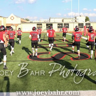 Great Bend Panther Jacob Murray (#7) leads the Offensive players in warmup stretches prior to the game. The Great Bend Panthers defeated the Dodge City Demons 34 to 27 at Memorial Stadium in Great Bend, Kansas on September 23, 2016. (Photo: Joey Bahr, www.joeybahr.com)