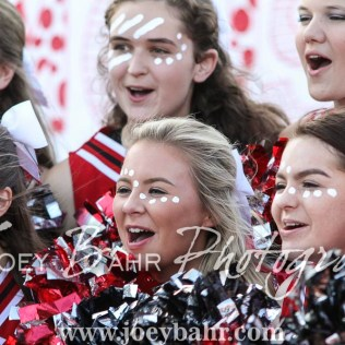 The Great Bend Panther Cheerleaders gather to cheer for a TV reporter. The Great Bend Panthers defeated the Dodge City Demons 34 to 27 at Memorial Stadium in Great Bend, Kansas on September 23, 2016. (Photo: Joey Bahr, www.joeybahr.com)