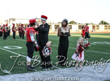 Past King Zach Dougherty crowns the 2016 King Payton Mauler during the Homecoming Festivities prior to the game. The Great Bend Panthers defeated the Dodge City Demons 34 to 27 at Memorial Stadium in Great Bend, Kansas on September 23, 2016. (Photo: Joey Bahr, www.joeybahr.com)