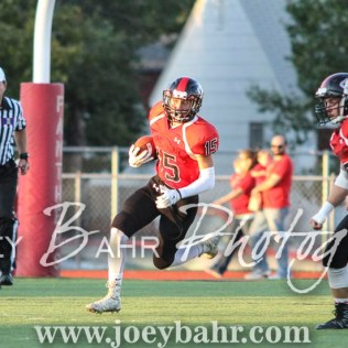 Great Bend Panther Nick Reed (#15) carries the opening kick off. The Great Bend Panthers defeated the Dodge City Demons 34 to 27 at Memorial Stadium in Great Bend, Kansas on September 23, 2016. (Photo: Joey Bahr, www.joeybahr.com)