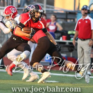 Great Bend Panther Koy Brack (#12) carries the ball up the field. The Great Bend Panthers defeated the Dodge City Demons 34 to 27 at Memorial Stadium in Great Bend, Kansas on September 23, 2016. (Photo: Joey Bahr, www.joeybahr.com)