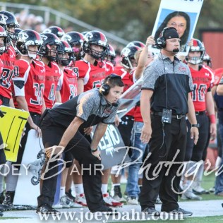 Great Bend Panther Head Coach Erin Beck watches a play develop. The Great Bend Panthers defeated the Dodge City Demons 34 to 27 at Memorial Stadium in Great Bend, Kansas on September 23, 2016. (Photo: Joey Bahr, www.joeybahr.com)